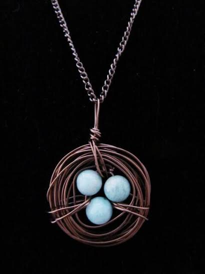 Brown bird nest necklace with genuine blue jade stones.