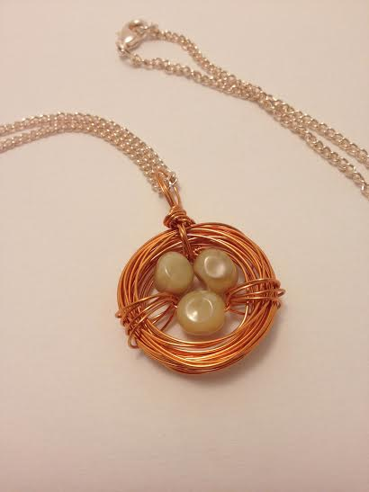 Copper bird nest necklace with genuine opal stones.