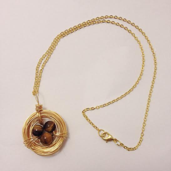 Gold bird nest necklace with genuine Tigers Eye stones.