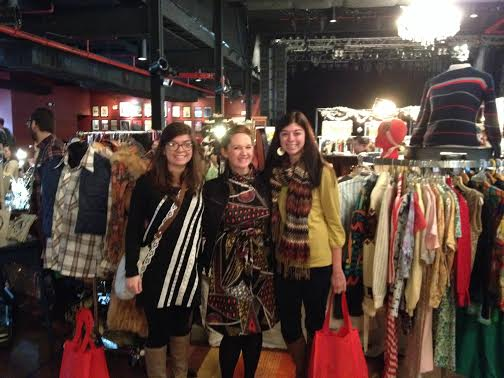 I'm always excited to see what Emily's mannequin is wearing because she has such great style! You can't see it here, but the behind me that mannequin is wearing a long sleeve floral print dress with a calf length fur vest - tres chic!