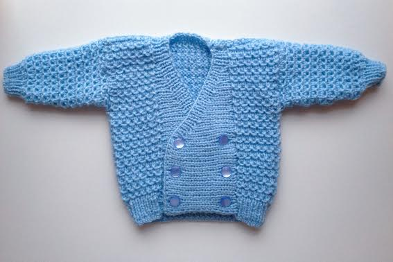 this itty bitty double breasted hand-knit sweater is quite possibly the cutest thing I've ever laid eyes on. I can hardly wait to see it on baby Graham!